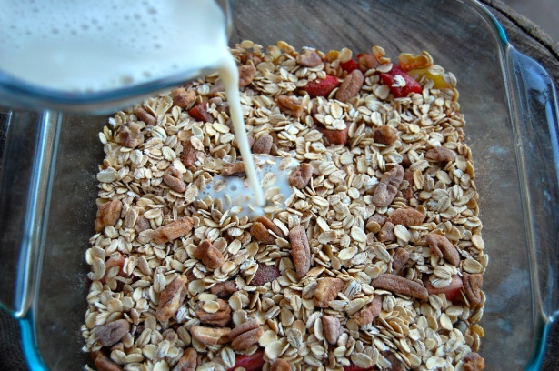 Pour milk mixture over the oats/nuts.