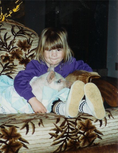 Just a girl and her pig watching cartoons...