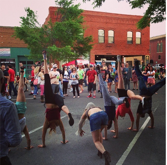 This is what happens when the yoga teachers get together… handstands in the street! Photo By Rebecca Borden.